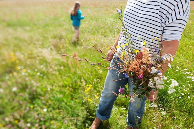 airport turned meadow - Iris and daughter Marie, picking flowers for oma - grandma