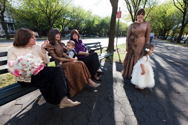 relatives of the bride and groom wait outside the Oholei Torah Center