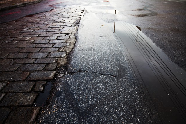 Belgian Block paving stones struggle against asphalt