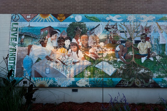 'love one another' - mural outside the Patrick Daly school
