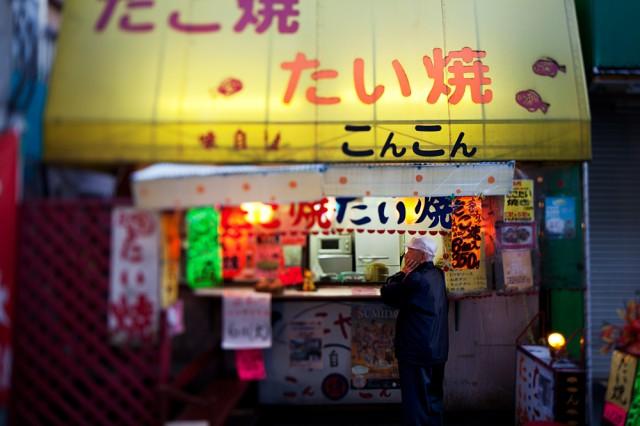 Mr Yamamoto waits for his takoyaki - octopus balls